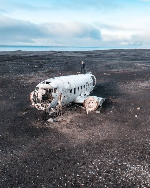 Solheimasandur DC-3 Plane Wreck in Iceland on a black sand beach. Full Iceland travel guide with a 6 day itinerary here.