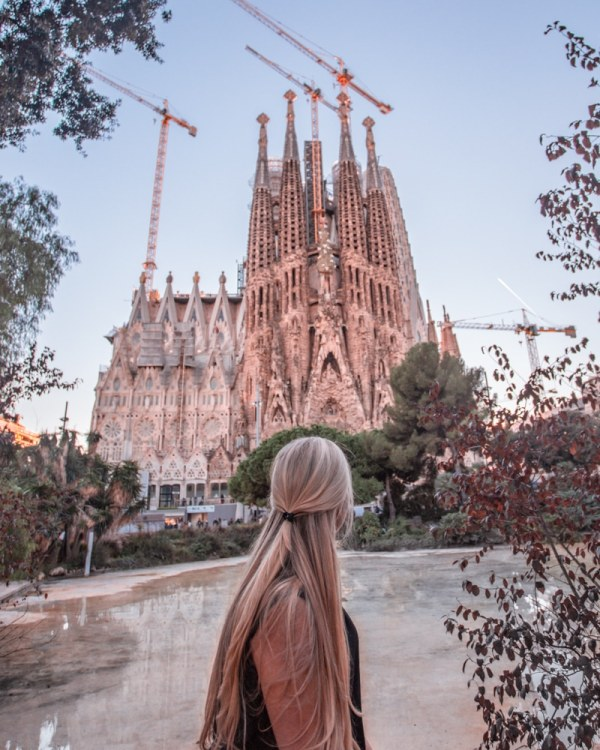 Sagrada Familia from the park across the street - one of the most famous Instagrammable places in Barcelona. Make sure to get our full guide to Barcelona here.