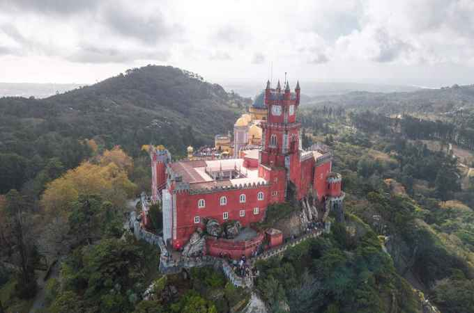 A drone shot of Pena Palace in Sintra. Get a full one day guide to Sintra here.