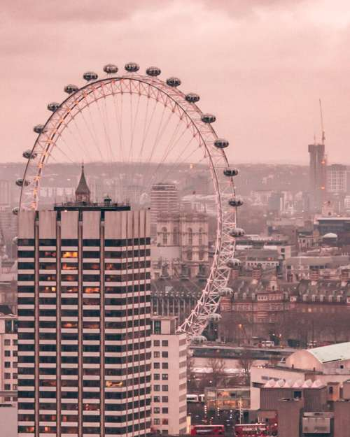 View of the London Eye from the dome at St. Paul's Cathedral near sunset. Get all the best London things to do in this itinerary for 3 days in London.