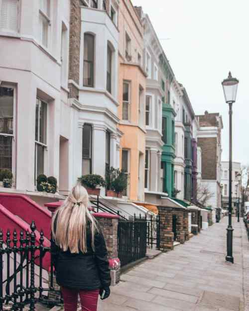 A colorful row of houses in Notting Hill in London. Click here for the best Instagram photo spots in London including the best streets in Notting Hill.
