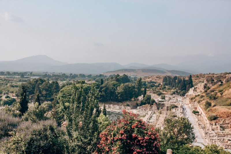 A view of ancient Ephesus and the surrounding areas from the Terrace Houses. Find a full one day itinerary with everything you need to know about visiting the ancient ruins of Ephesus in Turkey here.