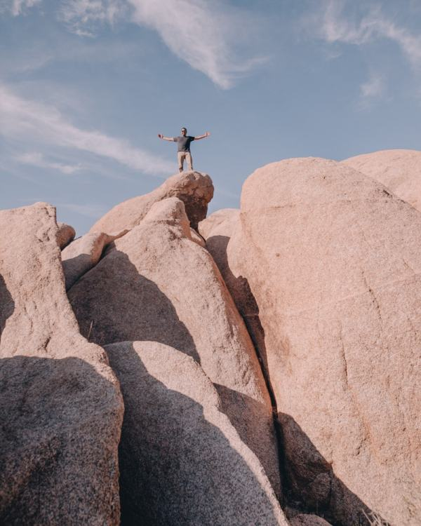 Climbing the rocks across from White Tank Campground in Joshua Tree National Park. Joshua Tree is the perfect stop on a road trip or for a one day stop, so here is a one day itinerary of all the spots you don't want to miss!