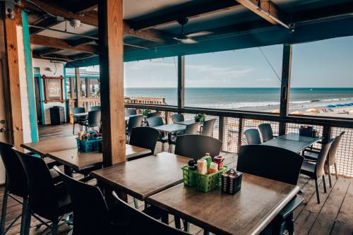 The Boardwalk Bar and beach view at Westgate Cocoa Beach Pier - get a full restaurant review here.