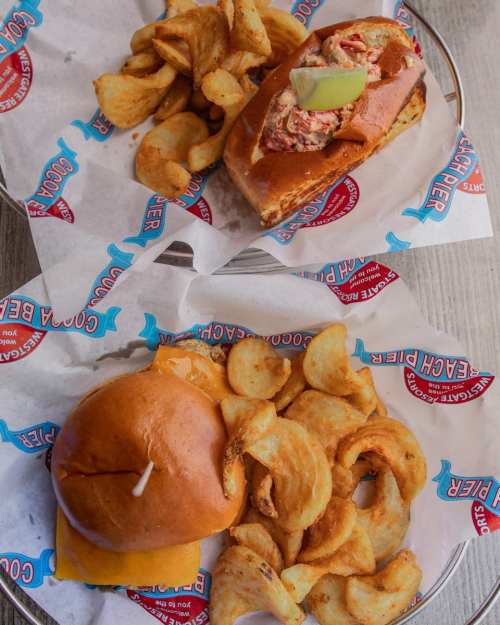 Lobster Roll and Chicken Sandwich at Pelican's Bar & Grille on the Westgate Cocoa Beach Pier - see a full review here!
