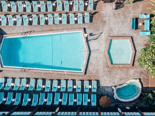 The main pool, kiddie pool and hot tub at Westgate Cocoa Beach Resort taken from a drone. Find a full review of Cocoa Beach's best beach hotel and resort here.