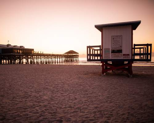 A lifeguard shack next to Westgate Cocoa Beach Pier at sunrise. Get a full review of Westgate Cocoa Beach Pier and the Cocoa Beach restaurants located there.