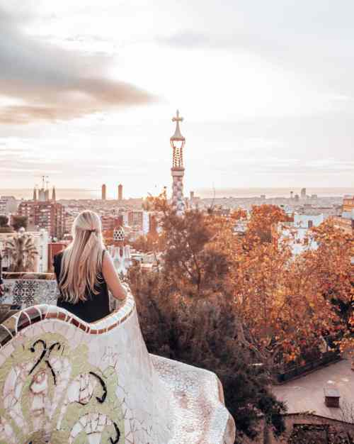 A woman looking out at Barcelona from the Greek Theater in Park Guell Monumental Zone