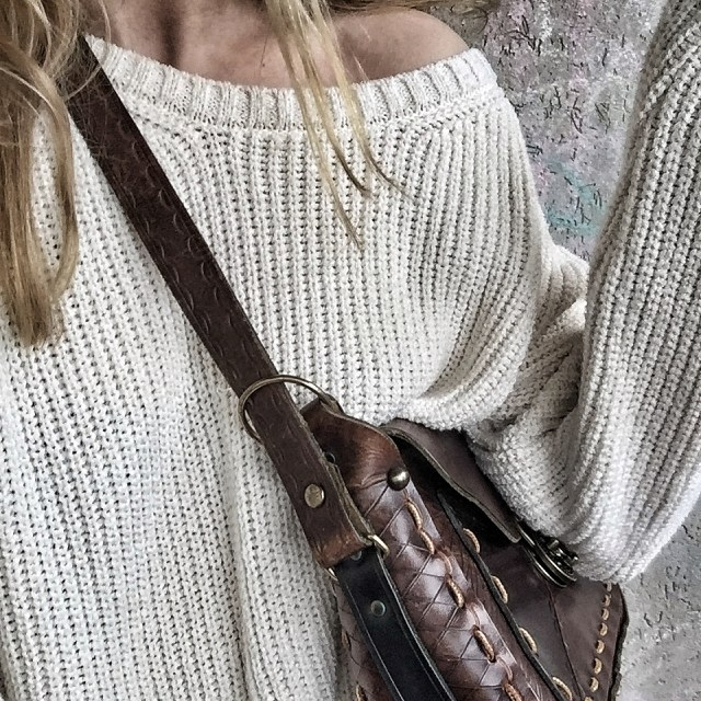 oversized sweater and vintage saddle bag purse