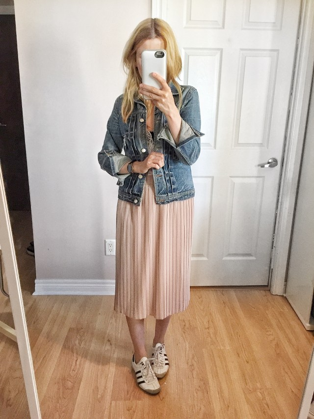 Pink pleated skirt, denim jacket, and Adidas