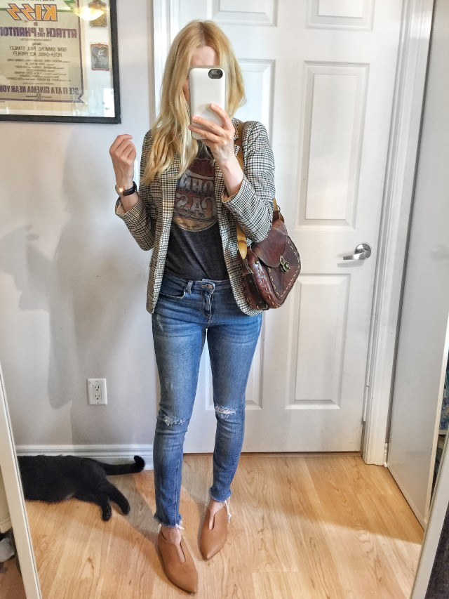 Houndstooth blazer, Johnny Cash T-shirt, jeans, and vintage purse