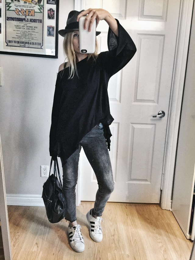 Oversized sweater, grey jeans, fedora, and Adidas