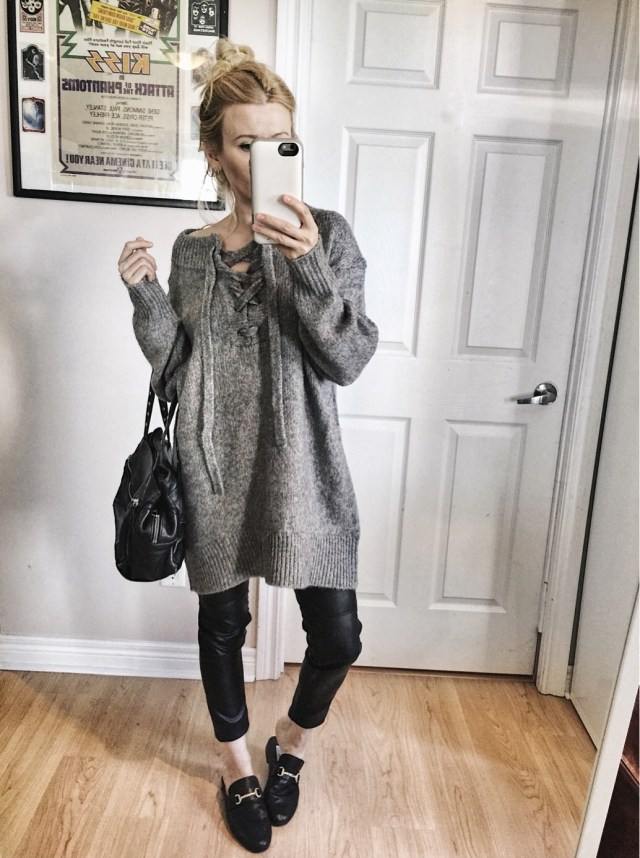Grey oversized sweater, faux leather pants, and slides
