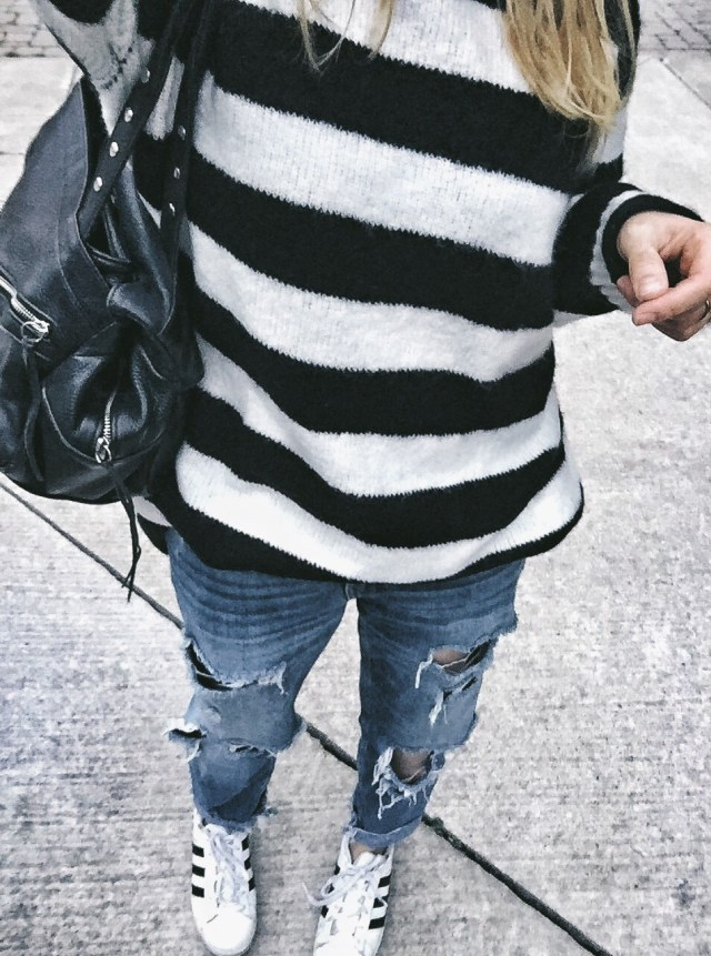 Oversized striped sweater, boyfriend jeans, and Adidas