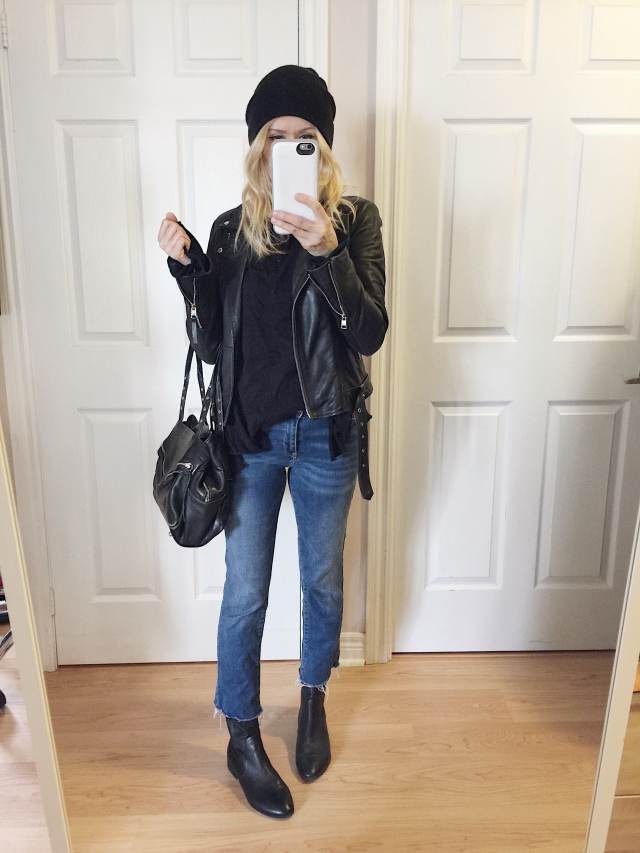 Cropped jeans, leather jacket, sock boots, and beanie