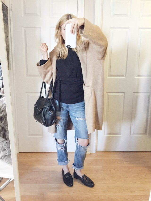 Tie waist sweatshirt, oversized coat, girlfriend jeans, and loafers