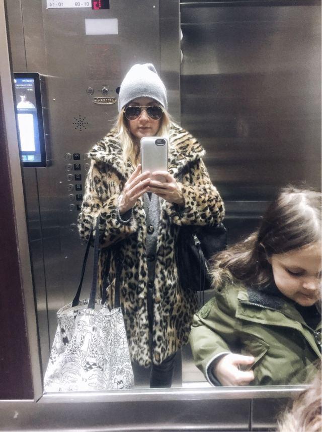 leopard print jacket, beanie, elevator selfie