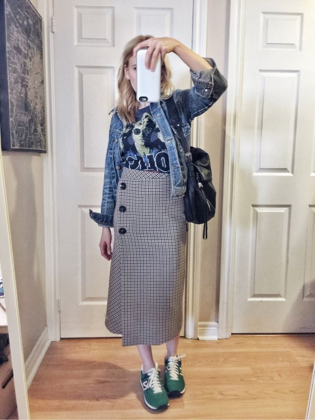 Check skirt, band tee, denim jacket, and green sneakers