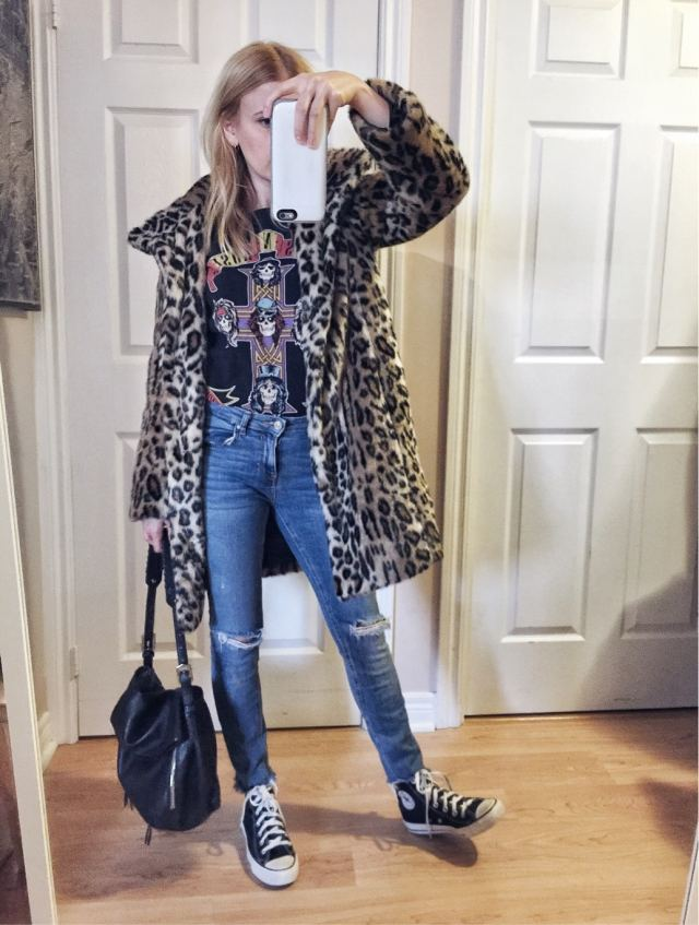 Band tee, animal print coat, skinny jeans, and converse