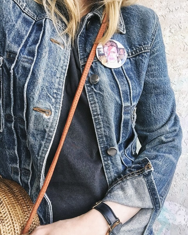 I am wearing a jean Jacket | Long t-shirt dress | a woven circle purse | and a Bowie pin
