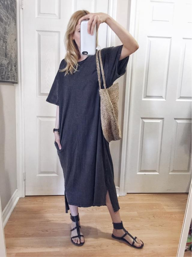 I am wearing a long, grey t-shirt dress | gladiator sandals | and a woven circle purse