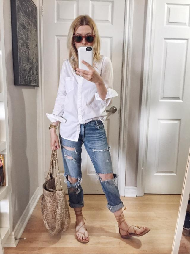 I am wearing boyfriend jeans, oversized white blouse, Madewell Boardwalk Sandals, vintage Ray-bans, and a circle purse
