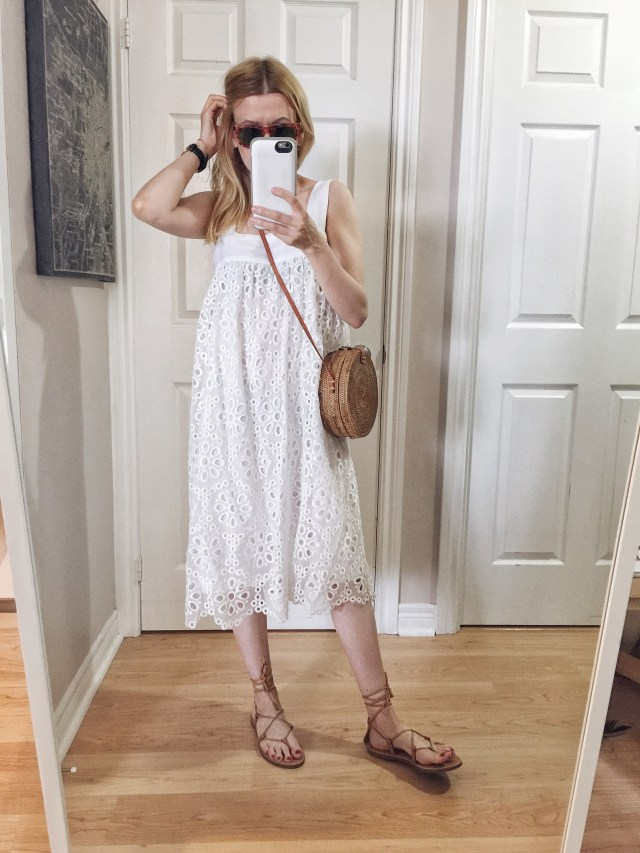 I am wearing a white lace summer dress, Madewell Boardwalk sandals, vintage ray-bans, and a small circle purse.