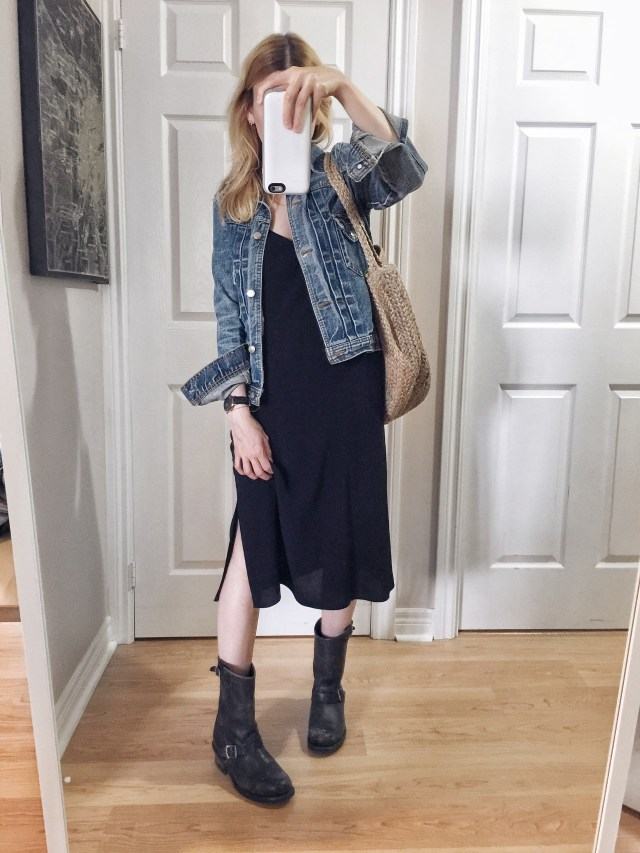 I am wearing a black slip dress, a vintage denim jacket, and Frye Engineer 12R boots