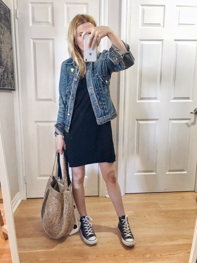 I am wearing a t-shirt dress, jean jacket, a large woven bag and converse high tops.
