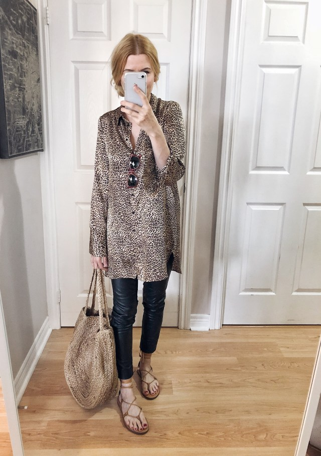 I am wearing a leopard print blouse, leather leggings, madewell sandals, and a large woven tote.