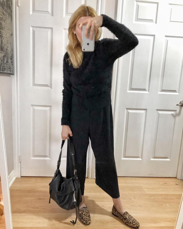 What I wore. A black jumpsuit, with a black sweater,and animal print Sam Edelman Loafers.