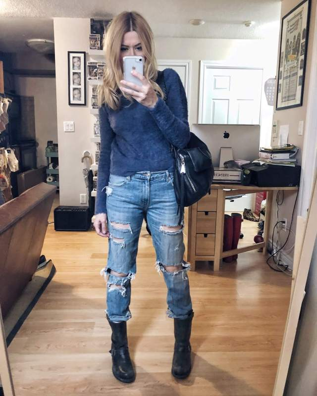 What I Wore. I am wearing a fuzzy blue sweater, boyfriend jeans, and a pair of Frye 12R Engineer boots.