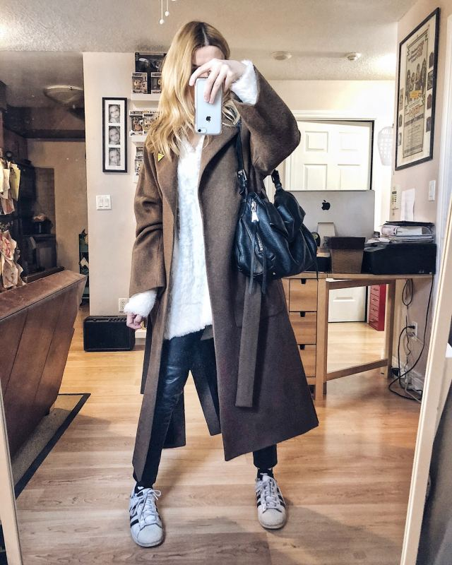 What I Wore. I am wearing a long brown wool coat, an oversized white sweater, faux leather leggings, and Adidas Superstars.