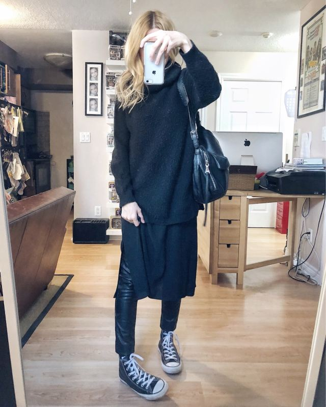 What I Wore. I am wearing a black oversized turtleneck sweater over a black slip dress, leather leggings, and Converse.