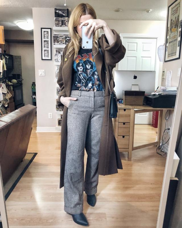 What I wore. I am wearing brown wool trousers, a vintage Kiss band t-shirt, a long brown wool overcoat, and black booties. #livelovesara