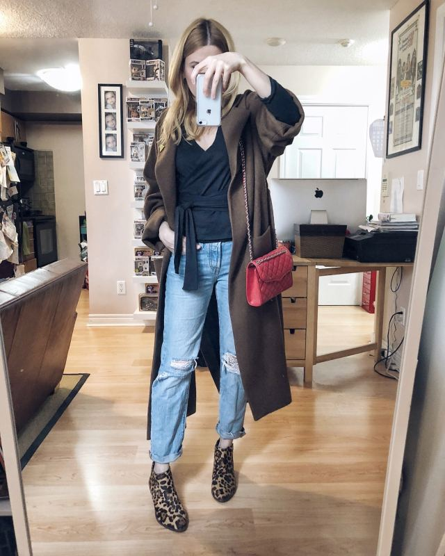 What I Wore. I am wearing a black wrap shirt from Able, Levi's 501 Taper cut, animal print booties, a long brown wool coat, and a red, quilted leather Rebecca Minkoff purse.