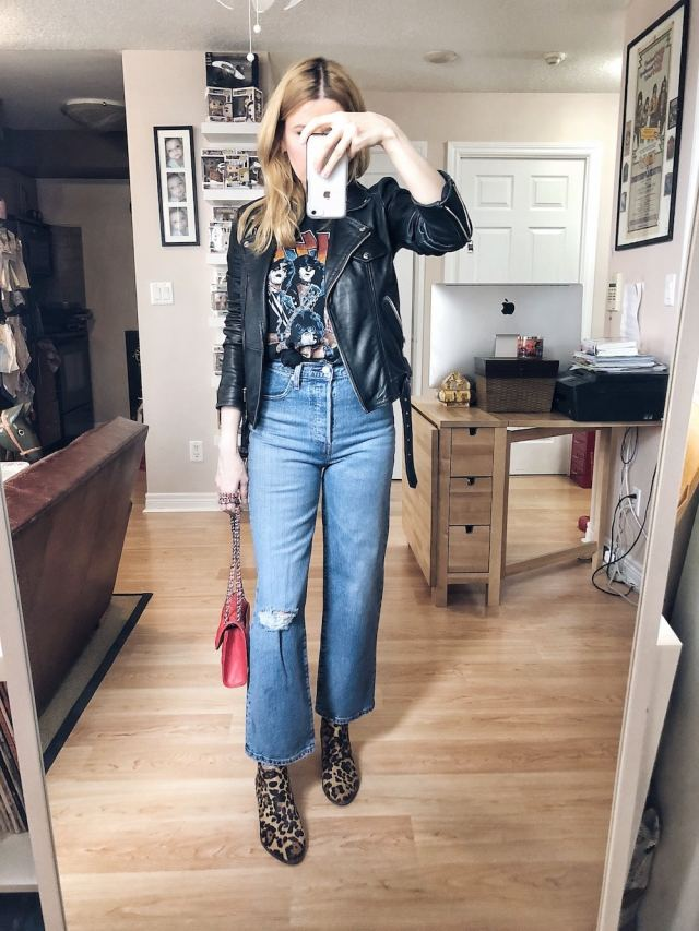 I am wearing Levi's Ribcage jeans, a vintage Kiss t-shirt, a leather moto, animal print boots, and a red purse. #livelovesara
