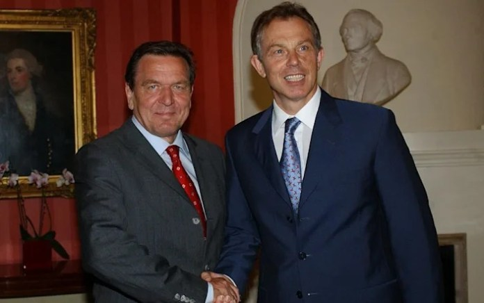 Gerhard Schröder ordered to pay £19,000 to wife's ex husband for causing split