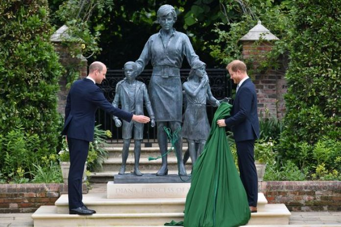 Prince Harry and William stand shoulder-to-shoulder to unveil statue of Princess Diana