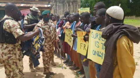 """""""I Should Forgive Them For Making Me A Young Widow"""" – Lady Cries Out As Nigerian Army Shares Picture Of Boko Haram Members Begging Nigerians For Forgiveness"""
