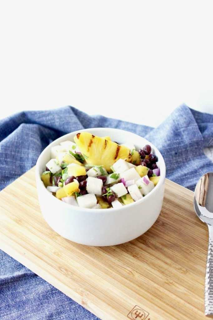 A refreshing grilled pineapple, black bean and jicama salad that is perfect served with grilled meals or used as a salsa! (vegan, gluten-free) | via livelytable.com