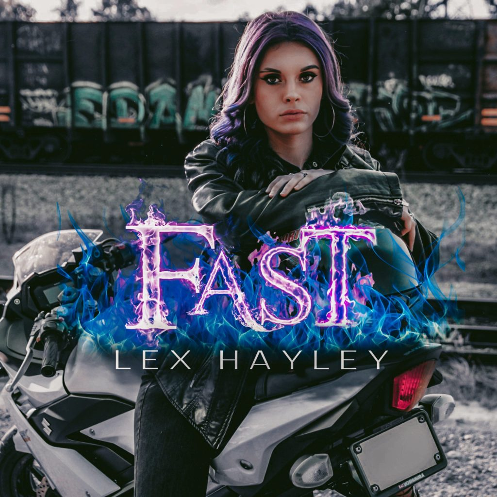 Lex Hayley the Music Artist sitting on a Motorbike, for Live Mic Records Label Services