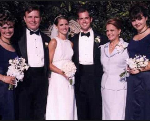 Marriage picture of Natalie Morales and Joe Rhodes.