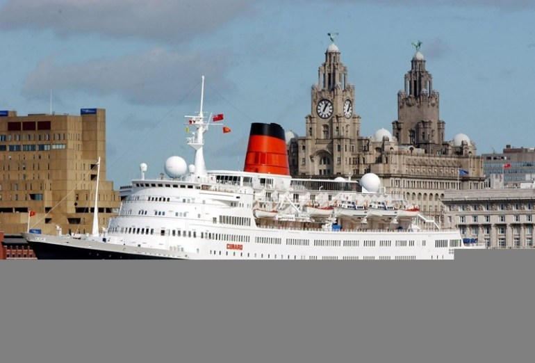 Cruise liner on the River Mersey with the Liver Buildings in the background