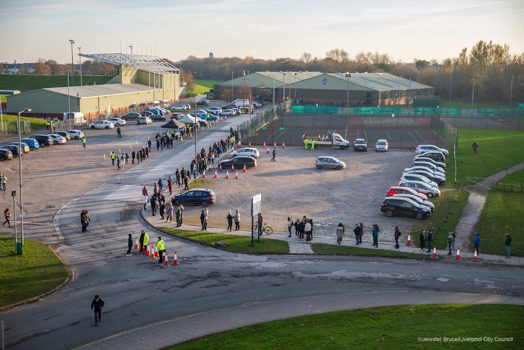 LIVERPOOL, ENGLAND. A view of the queue at the Liverpool Tennis Centre one of the Covid-19 mass testing sites in Liverpool. 6 November 2020.