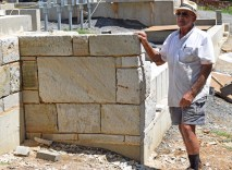 Stonemason Ray Cannetti inspects his handiwork.