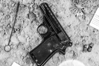 The very pistol used to give the 'Coup de Grace' to firing-squad victims.