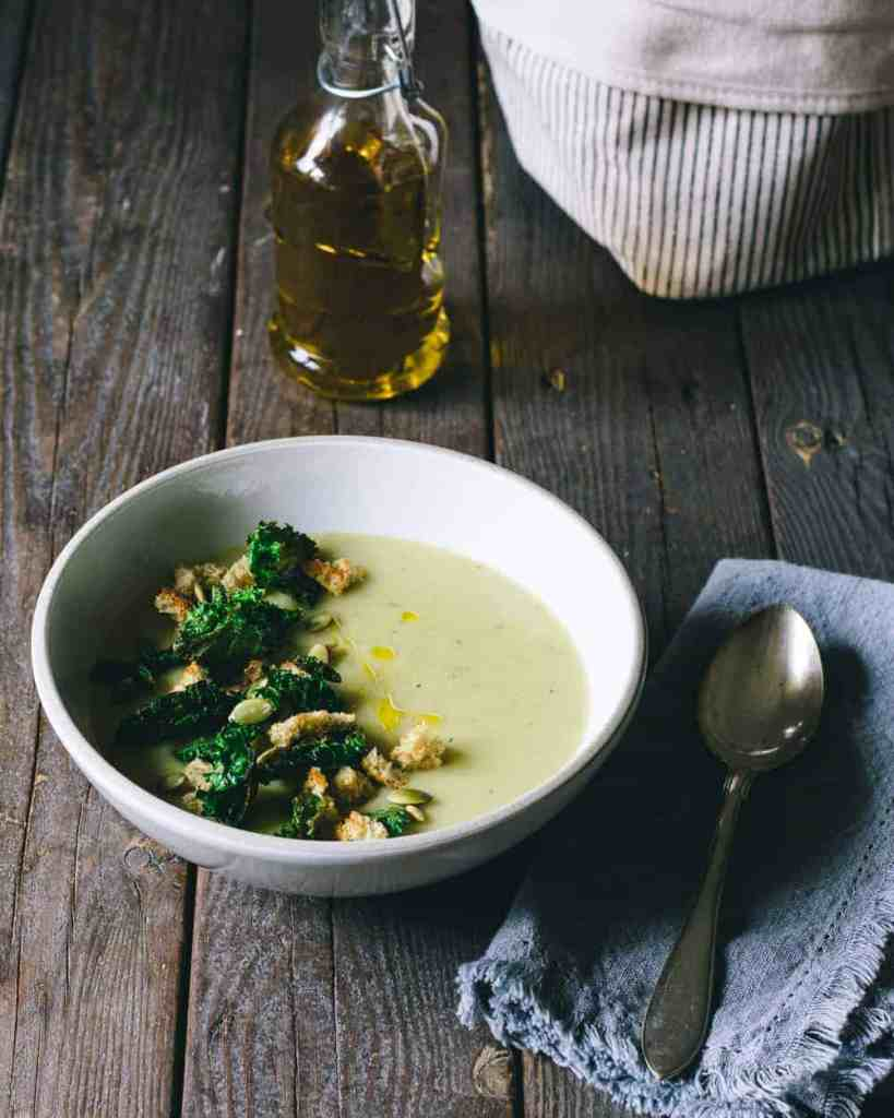 Potato leek soup on a table with canola oil
