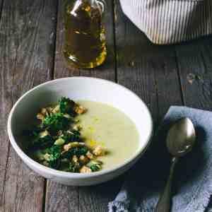 Potato leek soup on a table with canola oil