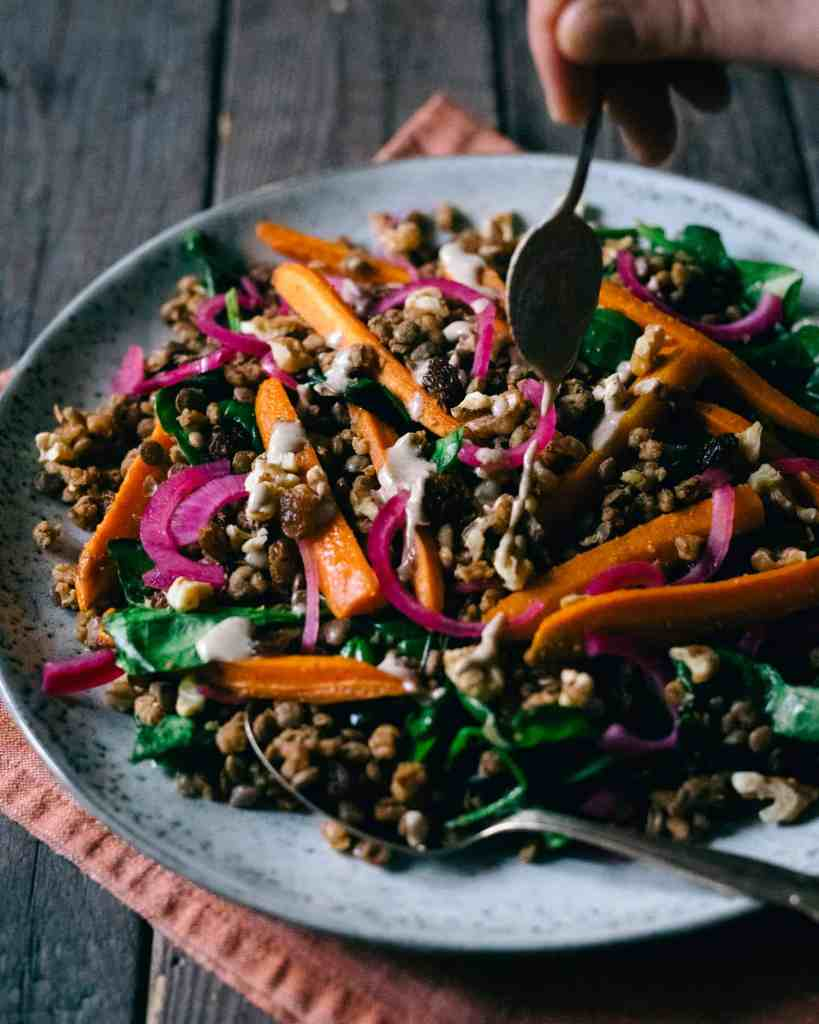 Lentil salad with carrots on a plate.